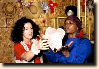 Anita Roddick and Mary changing hats