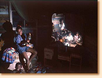 Children with oil lamp in Mississippi