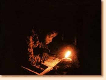 Reading in the glow of the kerosene lamp
