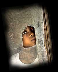 Black child in poverty - a victim of racism and social injustice. Click on all photos and reviews for enlargements and full text